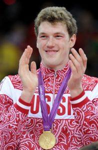 LONDON, GREAT BRITAIN. AUGUST 12, 2012. Russia's Dmitry Musersky celebrates during the Victory Ceremony after his team won gold in the Men's Volleyball at the London 2012 Olympic Games. (Photo ITAR-TASS / Valery Sharifulin) Âåëèêîáðèòàíèÿ. Ëîíäîí. 12 àâãóñòà. Èãðîê ñáîðíîé Ðîññèè Äìèòðèé Ìóñýðñêèé âî âðåìÿ öåðåìîíèè íàãðàæäåíèÿ ðîññèéñêîé ñáîðíîé, çàâîåâàâøåé «çîëîòî» âîëåéáîëüíîãî òóðíèðà, íà ÕÕÕ ëåòíèõ Îëèìïèéñêèõ èãðàõ. Ôîòî ÈÒÀÐ-ÒÀÑÑ/ Âàëåðèé Øàðèôóëèí